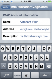 Settings screen for Mail on the iPhone showing an email alias added to an account.